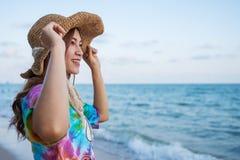 Woman wearing hat standing on sea beach. Woman wearing hat standing on the sea beach stock image