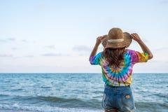 Woman wearing hat standing on sea beach. Woman wearing hat standing on the sea beach stock photography