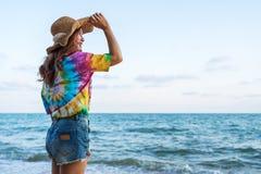 Woman wearing hat standing on sea beach. Woman wearing hat standing on the sea beach royalty free stock photos