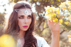 Woman Wearing Head Band Examining Tree Blossoms Royalty Free Stock Images