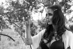 Woman Wearing Head Band near Flowering Tree Stock Photography