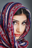 Woman wearing head scarf Royalty Free Stock Images