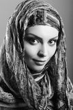 Woman wearing head scarf Stock Image