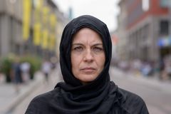 Woman wearing a head scarf in an urban street stock photos