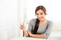 Woman wearing headphone with music player Stock Photos