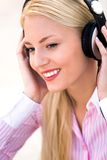 Woman wearing headphones Royalty Free Stock Images