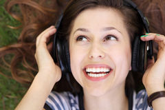 Woman wearing headphones Royalty Free Stock Photos