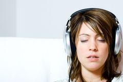 Woman wearing headphones Royalty Free Stock Photography