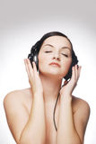 Woman wearing headphones Stock Image