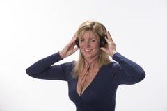 Woman wearing headphones Stock Image