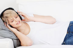 Woman wearing headphones listening to music Royalty Free Stock Photo