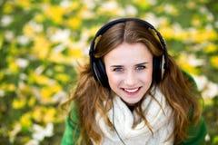 Woman wearing headphones outdoors Stock Image