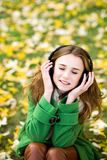Woman wearing headphones outdoors Royalty Free Stock Image