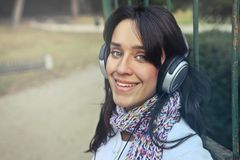 Woman Wearing Headphones With Scarf Royalty Free Stock Image