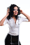 Woman wearing headphones singing Stock Images