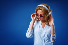 Woman wearing headphones and sunglasses Stock Image