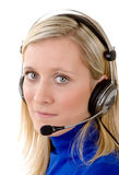 Woman wearing a Headset Stock Images