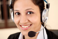 Woman wearing headset Stock Image