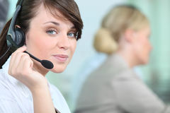 Woman wearing headset Royalty Free Stock Images