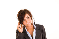 Woman wearing headset. Professional woman wearing a headset.  Isolated against a white background Stock Photos