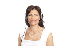 Woman wearing headset Stock Images