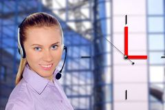 Woman wearing headset in office;could be reception Stock Images