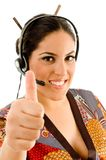 Woman wearing headset and showing thumbs up Stock Image