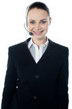 Woman wearing headsets, could be receptionist. Isolated over white Stock Photography
