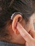 Woman wearing hearing aid Royalty Free Stock Image
