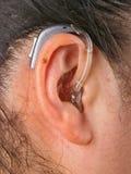 Woman wearing hearing aid Royalty Free Stock Photos