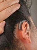 Woman wearing hearing aid Royalty Free Stock Photo