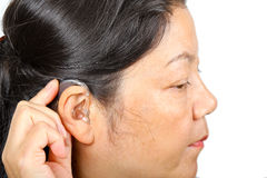 Woman wearing hearing aid Stock Photo