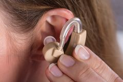 Woman Wearing Hearing Aid. Close-up Photo Of Woman Wearing Hearing Aid stock image
