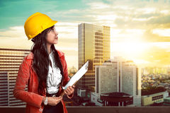 Woman wearing helmet holding clipboard Stock Photos
