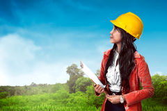 Woman wearing helmet holding clipboard Royalty Free Stock Image