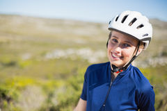 Woman wearing helmet smiling Royalty Free Stock Photos