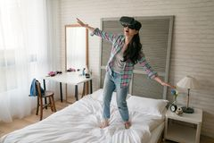 Woman wearing her VR device and open her arms stock photography