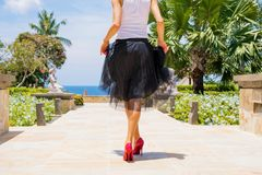 Woman wearing high heels and black skirt Royalty Free Stock Photo