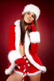 Woman wearing holiday clothes on r Royalty Free Stock Photos