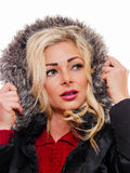 Woman wearing hood. A attractive blond woman is wearing a coat with the hood pulled up around her stock image