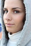 Woman wearing hooded coat Stock Photo