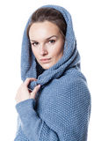 Woman wearing hooded sweater Stock Photos