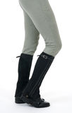 Woman wearing horse riding boots and breeches. On white background royalty free stock photography