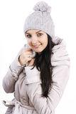 Woman wearing jacket and cap Stock Images