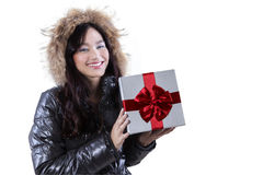 Woman wearing jacket holds a gift Royalty Free Stock Images