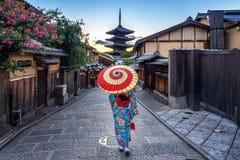 Woman wearing japanese traditional kimono with umbrella at Yasaka Pagoda and Sannen Zaka Street in Kyoto, Japan royalty free stock images