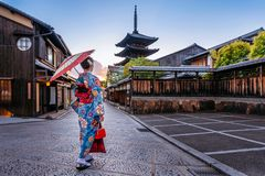 Woman wearing japanese traditional kimono with umbrella at Yasaka Pagoda and Sannen Zaka Street in Kyoto, Japan.  stock image