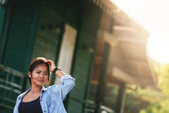 Woman  wearing jeans and a denim jacket. She relax in the holida Royalty Free Stock Photo