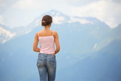 Woman wearing jeans looking at mountain Stock Photos
