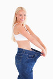 Woman wearing jeans in too big  a size Royalty Free Stock Photos